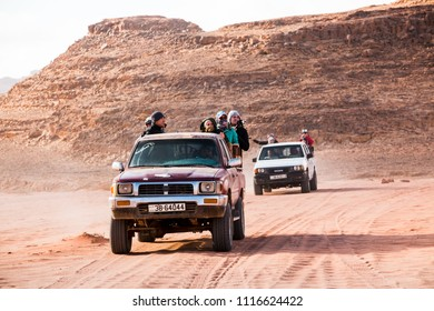 Wadi Rum, Jordan - December, 25, 2017: Bedouin's car jeeps and tourists in it in Wadi Rum desert in Jordan