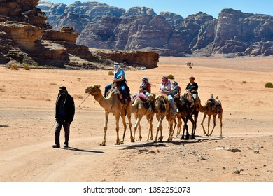 WADI RUM, JORDAN - MARCH 07: Group of woman take a ride on camels in the desert scenery in Middle East, on March 07, 2019 in Wadi Rum, Jordan