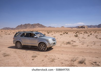 WADI RUM, JORDAN - MAY 08, 2015: Off-road vehicle through the desert