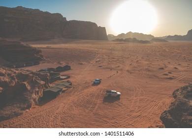 Wadi Rum, Jordan - May, 15, 2019: Bedouin's car jeeps and tourists, Wadi Rum desert in Jordan, Middle East.