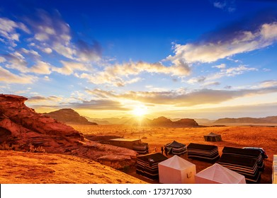 Wadi Rum in Jordan at sunset.  Wadi Rum is known as The Valley of the Moon and has led to its designation as a UNESCO World Heritage Site.