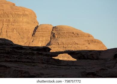 Wadi Rum (The Moon Valley) desert landscape at sunset time, Jordan