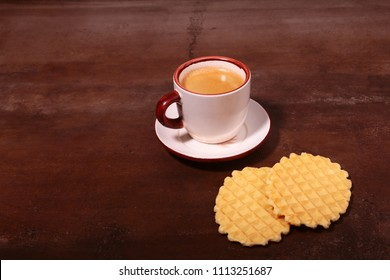Wafel, caramel waffle and coffee cup, coffeebreak isolated on dark background