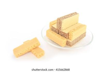 wafer chocolate milk dessert  on glass plate on white background