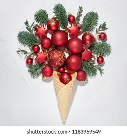 Wafer cone, Christmas balls and fir branch flat lay