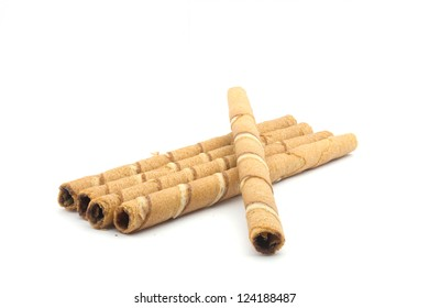 Wafer roll sticks cream rolls over a white background