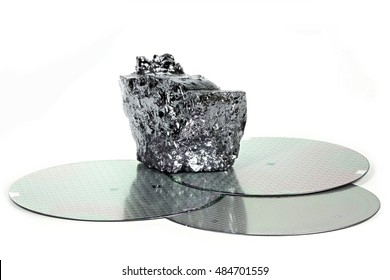 wafers with piece of polycrystalline silicon isolated on white background