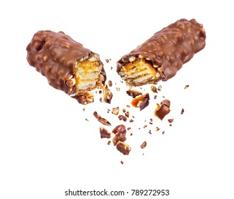 Waffle chocolate bar with nuts broken into two parts close up, isolated on white background