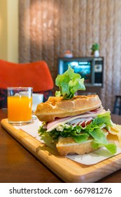 waffle club sandwich with ham, cheese, egg, tomatoes, vegetable and juice, delicious breakfast for a fresh morning