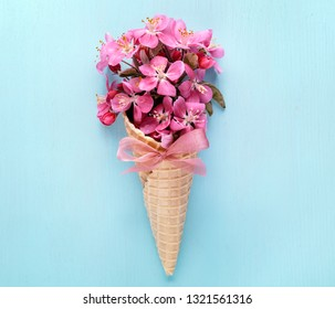 Waffle cone with bouquet of Flowers,Spring summer floral concept.