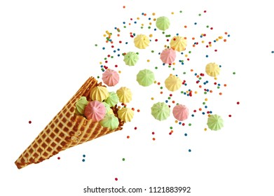 waffle  cone with colorful meringues and with confectionery decorations on white background, holiday concept