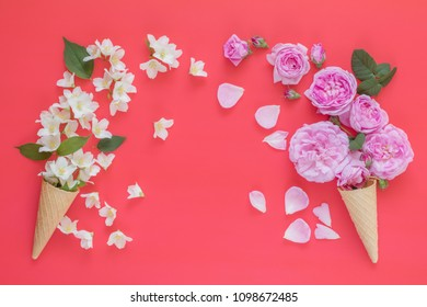 Waffle cone with pink roses and jasmine flowers bouquet on pink background. Flat lay, top view floral background.