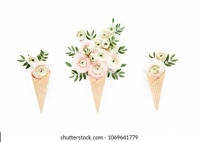 Waffle cone with ranunculus flower bouquet on white background. Flat lay, top view floral background.