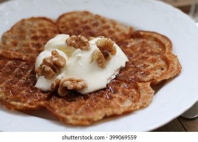 Waffle with cream, honey and walnuts.