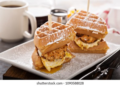 Waffle, fried egg and fish sandwich, southern breakfast