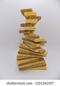 Waffle handmade stairs.Waffer with banana and chocolate cream on white background