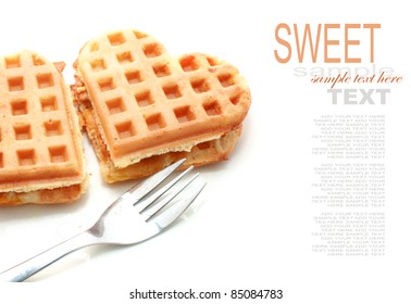 Waffle in heart shape isolated on white