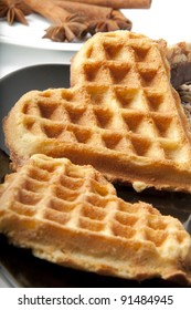 Waffle in heart shape isolated on black