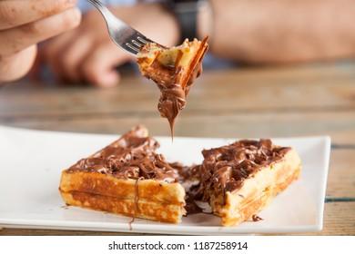 Waffle pancake chocolate snack on fork