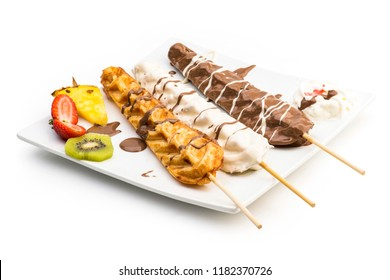 Waffle Sticks dipped with chocolate, Fruits and whipped cream Isolated on white background, Clipping path included