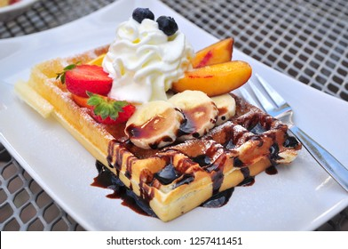 Waffle sweet dessert with fruit and chocolate