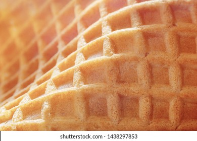 Waffle texture. Textured wafer close-up. Baking background.