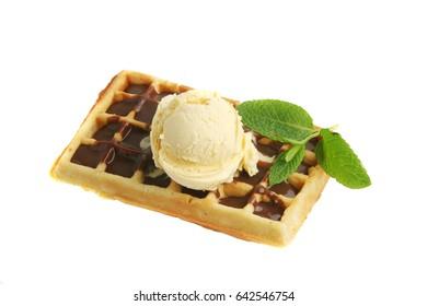 Waffle with vanilla ice cream and mint