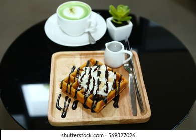 waffle and whipped cream with chocolate sauce
