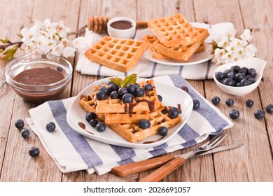 Waffles with blueberries and chocolate cream.