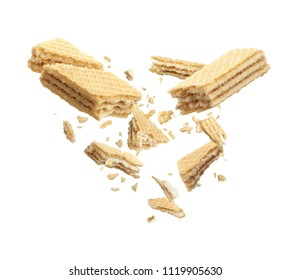 Waffles broken in half, isolated on white background