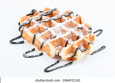 Waffles with chocolate. Homemade Belgian waffles stack, a delicious dessert on white background