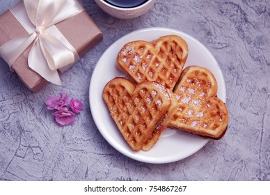 Waffles with Cream Heart Shape and Gift Craft Box eith Ehite Ribbon.
