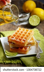 Waffles with honey and lemon slices