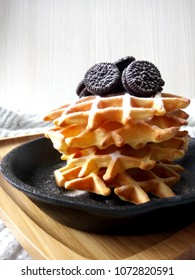 waffles with icing sugar and chocolate cookies