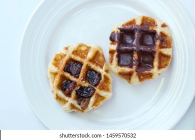 Waffles on white plate, white background