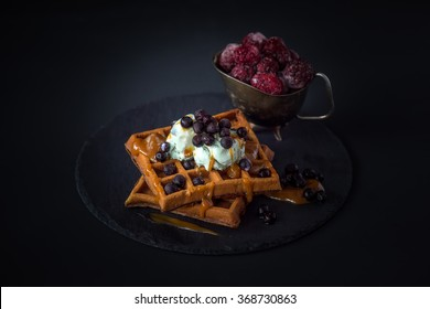 Waffles with pistachio ice cream, blueberries, blackberries and