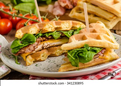 Waffles sandwich with bacon, chicken and fresh salad