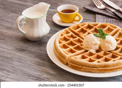 Waffles served with ice cream coffee and cream