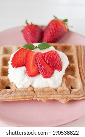 Waffles with strawberries for breakfast