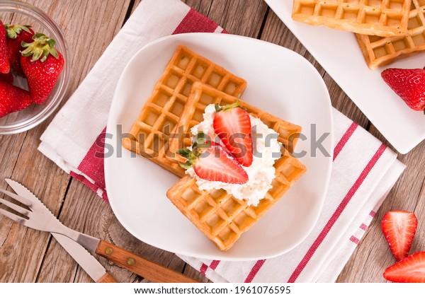 waffles-strawberries-whipped-cream-600w-