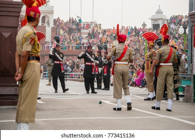 Wagah Atari Amritsar Punjab India April,05,2014:  flag ceremony by Border Security Force guards at India-Pakistan border, Wagah, Attari,Amritsar, Punjab,India,Asia