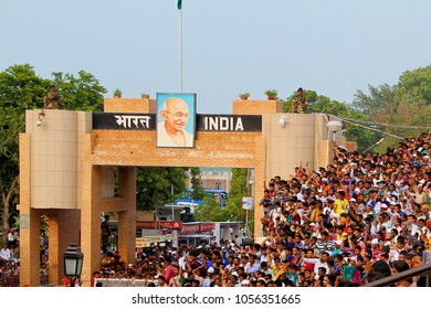 Wagah Border (Atari), India - 7th June 2014: People sitting on a gallery to watch the evening flag lowering ceremony at Wagah Border