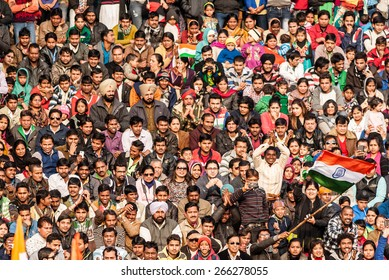 WAGAH, INDIA, JANUARY - 26, 2015: Crowd of Indian people celebrating at India-Pakistan Wagah border flag ceremony during the India Republic Day on January, 26 2015 in Wagah, India.