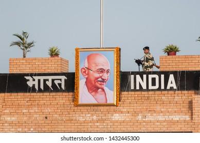 WAGAH, INDIA - NOVEMBER 26, 2015: An Indian guard at the ceremonial flag lowering on India-Pakistan border at Wagah, Amritsar, Punjab, India, Asia.