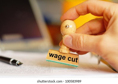 wage cut concept with stamp in office or bureau showing financial crisis
