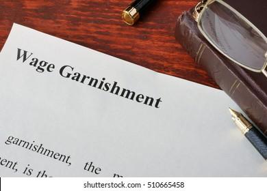Wage Garnishment definition written on a paper.