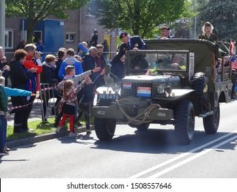 Wageningen, the Netherlands - 5/5/2018: Children shake hands with army veterans during liberation day parade in Wageningen.