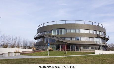 WAGENINGEN, NETHERLANDS - FEBRUARY,24 2014: Round high school building near the Wageningen Univeristy and Research Campus  in Wageningen..