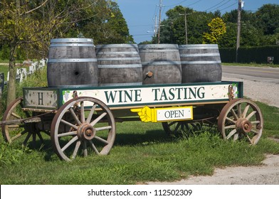 A wagon filled with barrels advertising a wine tasting
