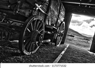 Wagon in an open door barn both from late 1800's-early 1900's, found at a ghost town in California